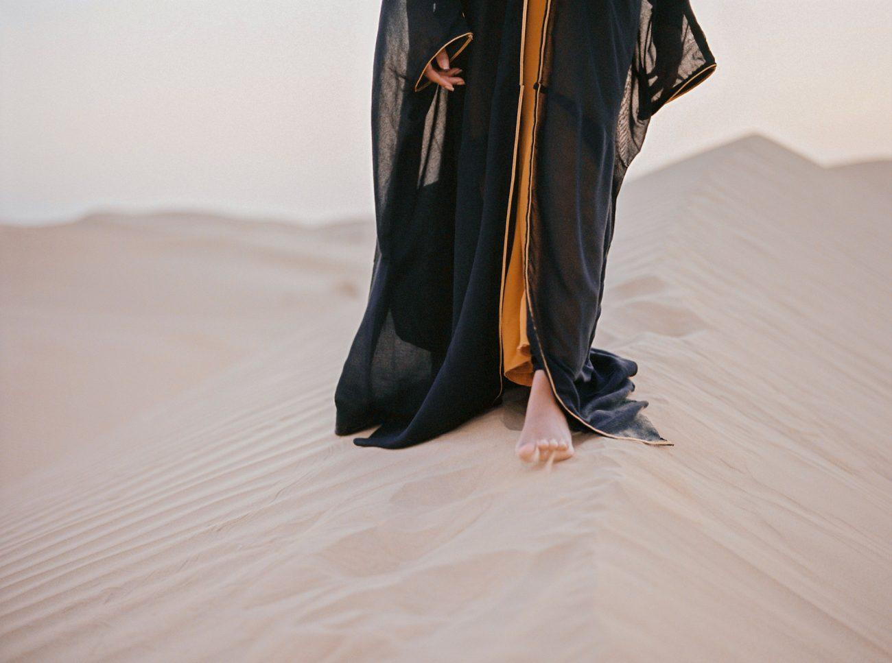 Desert fine art wedding inspiration black robe