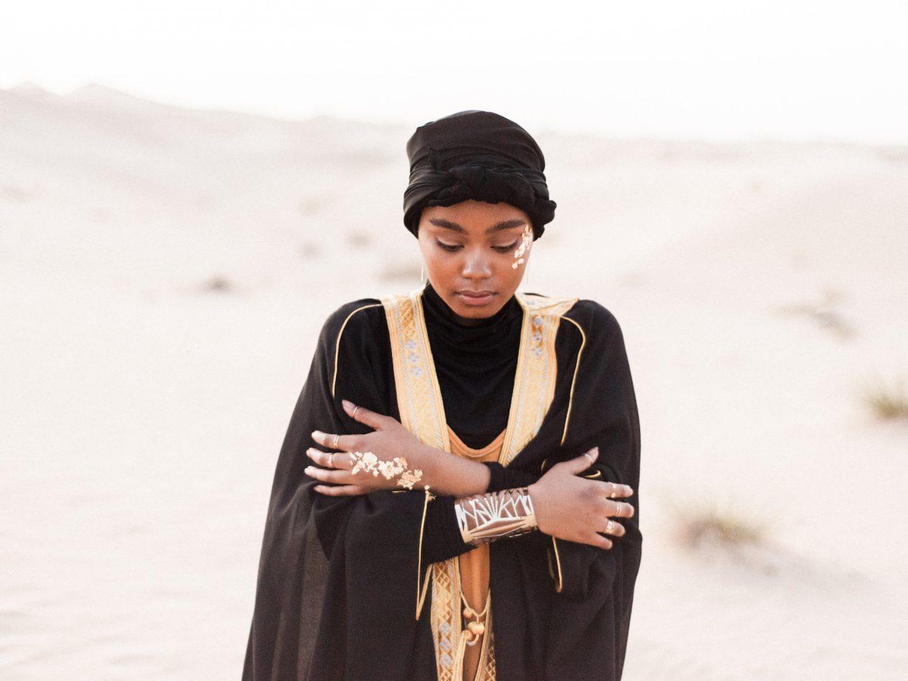 Desert fine art wedding inspiration bride with gold bracelet in desert