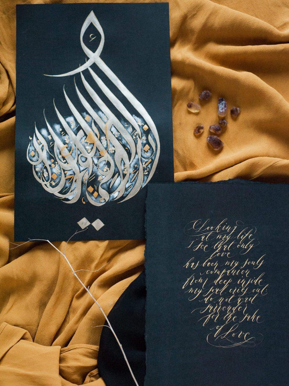 Desert fine art wedding inspiration gold Arabic calligraphy art stones