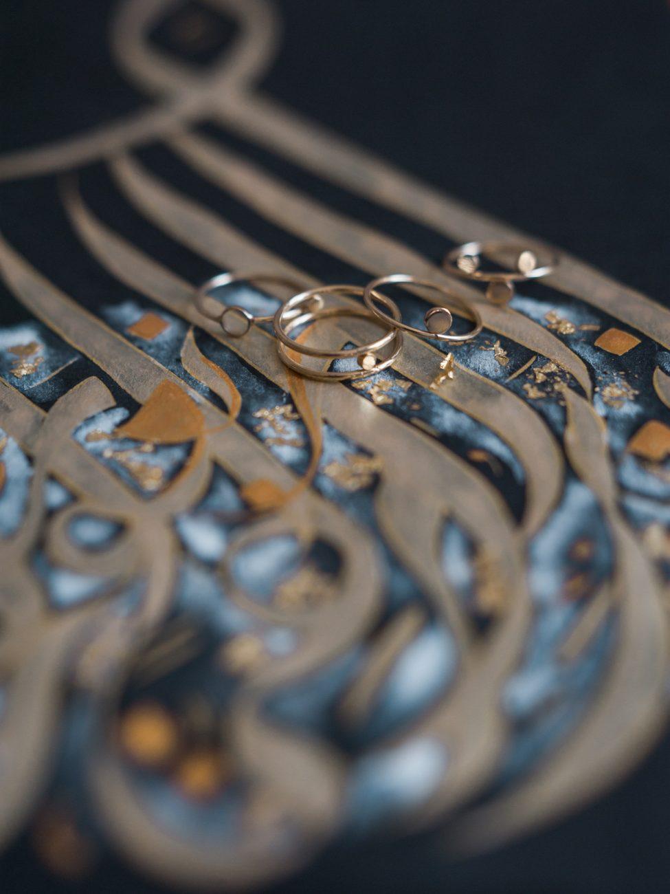 Desert fine art wedding inspiration gold Arabic calligraphy art with rings