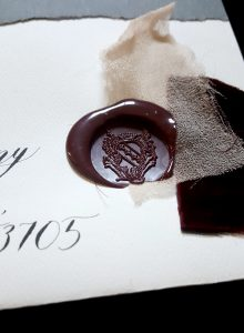 French Style Wedding Invitations burgundy wax close up view with chiffon
