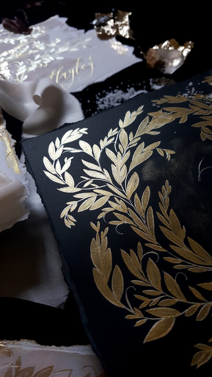 Custom Gold Foil Invitations - black table number with gold paint detail