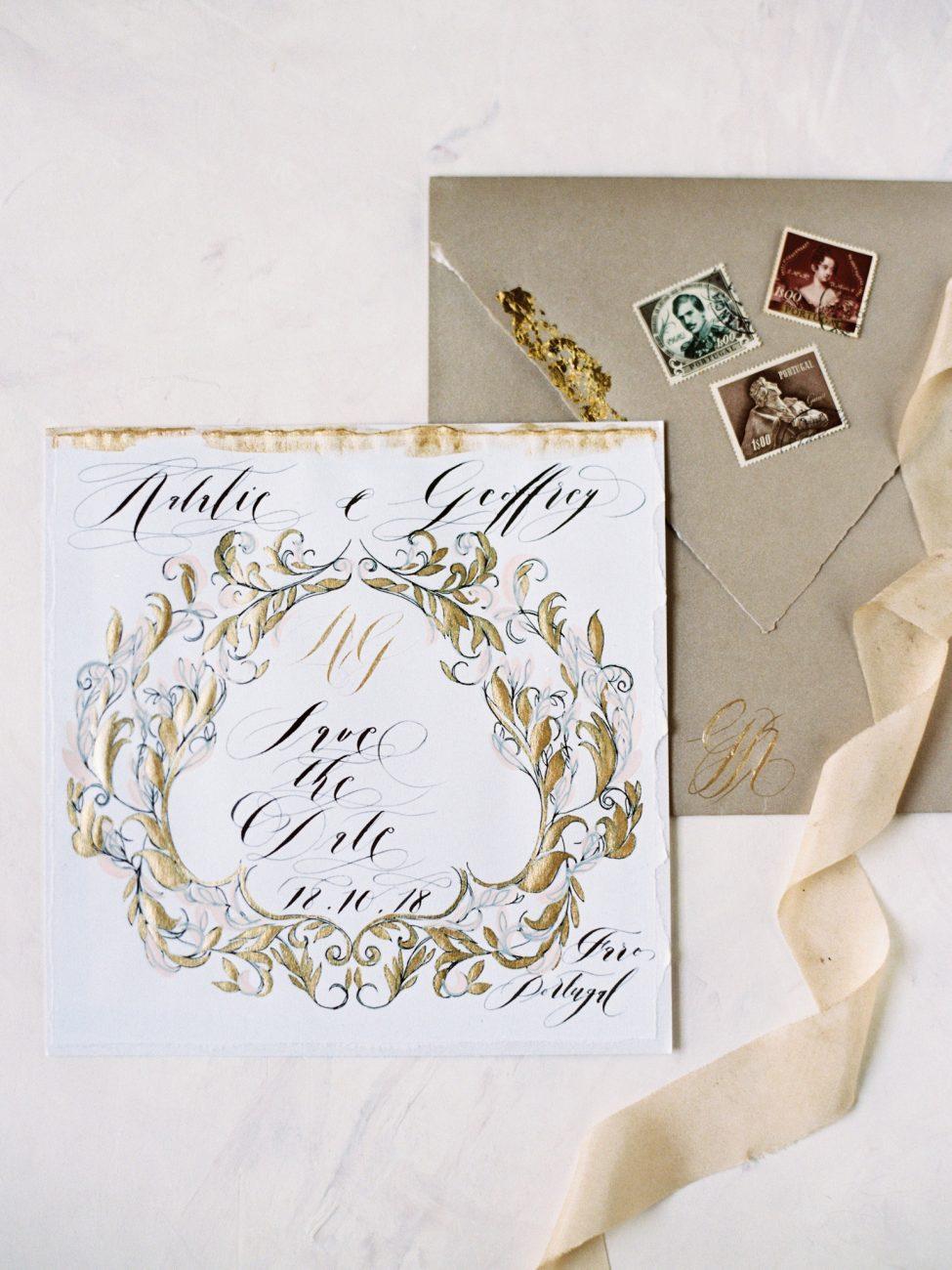 Gold wedding stationery suite with dark gold envelope