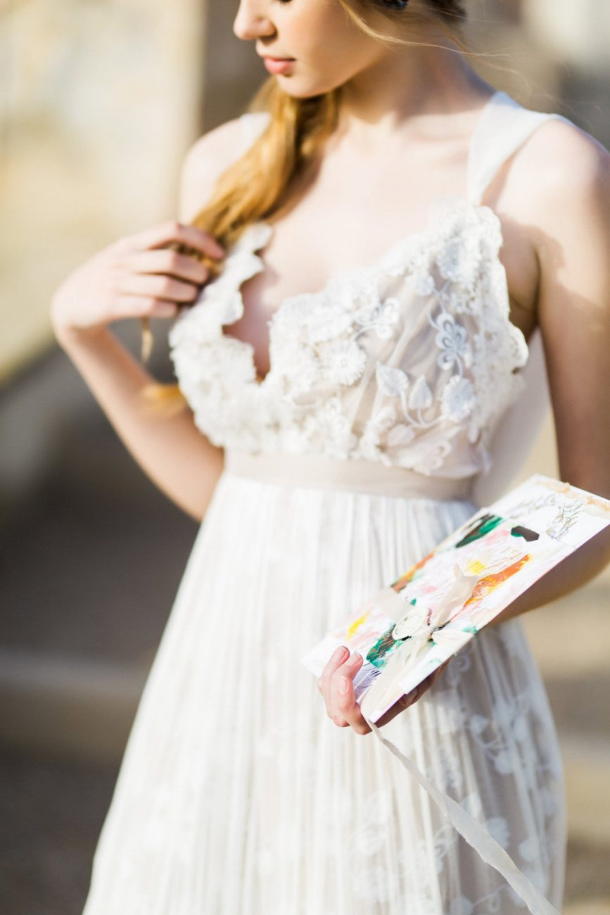 Palace Wedding Inspiration bride holding artwork