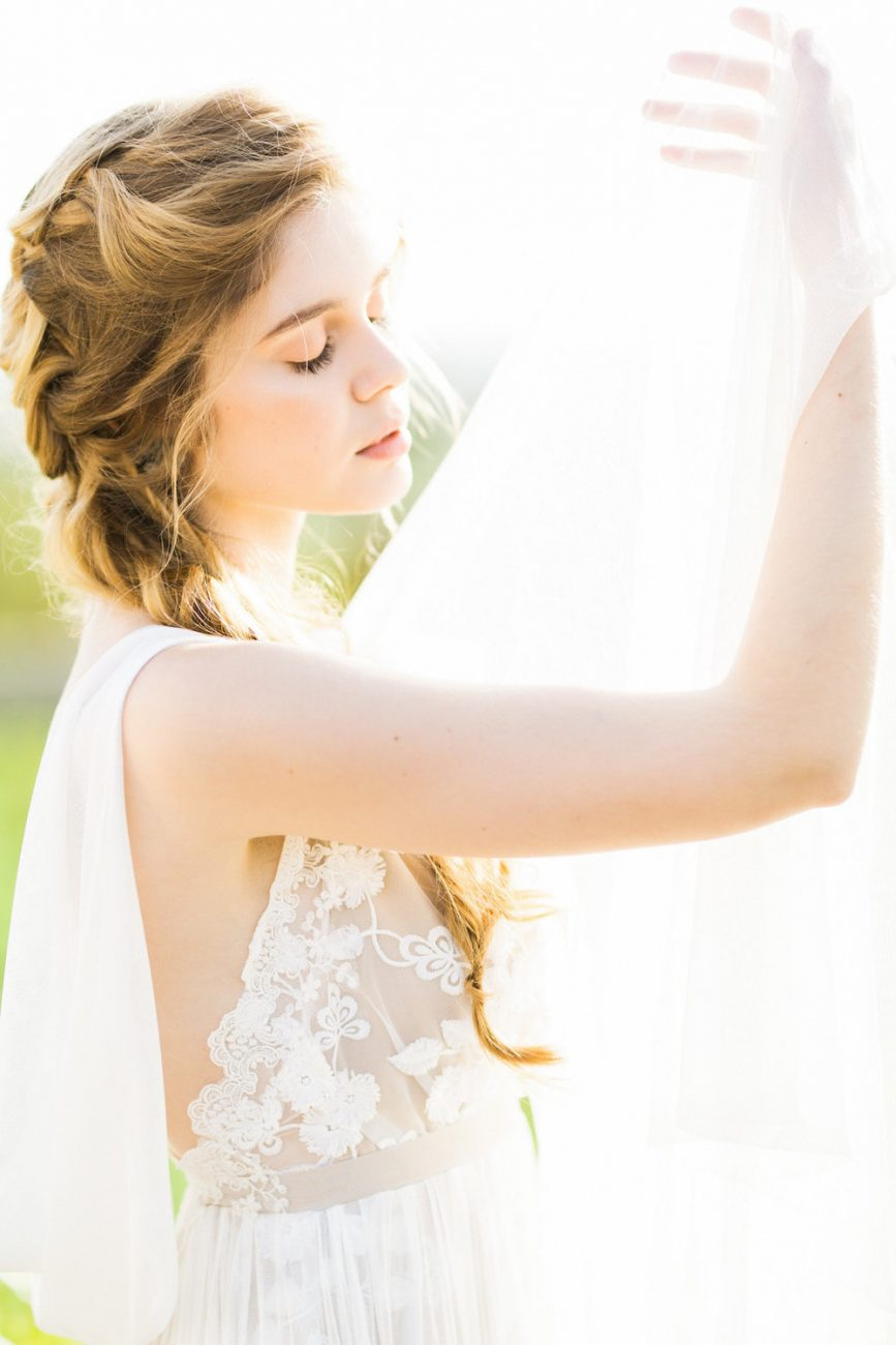 Palace Wedding Inspiration bride in sunlight with veil