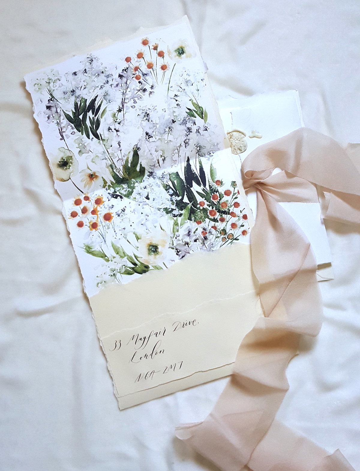 Bespoke Watercolour Wedding Invitations featuring the envelope liner and invite with ribbon copy