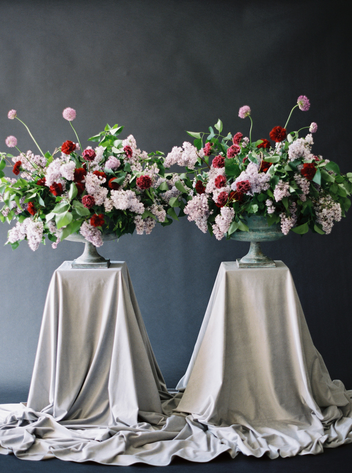 Moody Black Wedding Inspiration Two Large Flower Urns With Red And Light Pink Flowers Crimson Letters