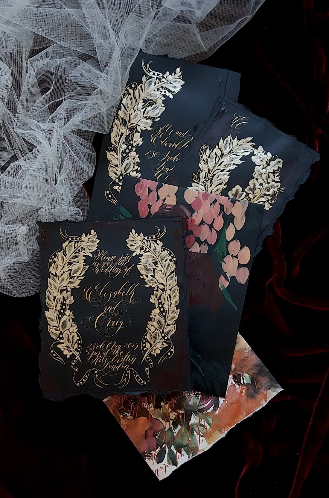 London Wedding Invitations featuring heavily hand painted gold baroque detail on black invitations