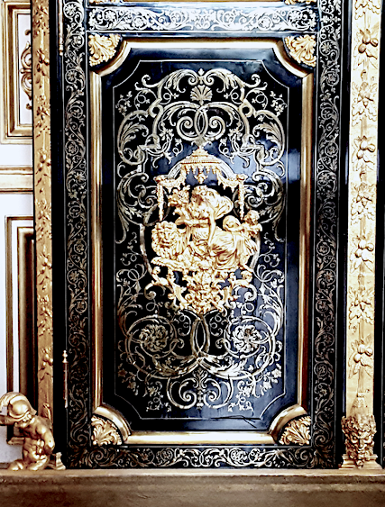 Luxury handmade wedding cards a door from a French Palace with gold ornate patterns on a black door