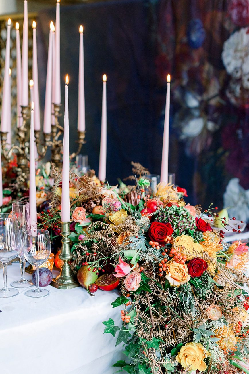 Baroque Wedding table edge with large flowers arrangement with red and yellow roses