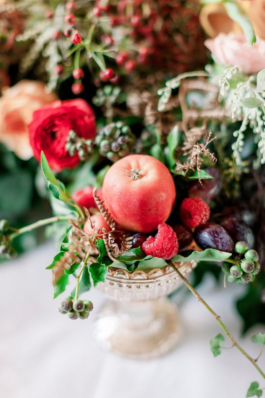 Baroque wedding inspiration with rich fruits placed onto a table setting