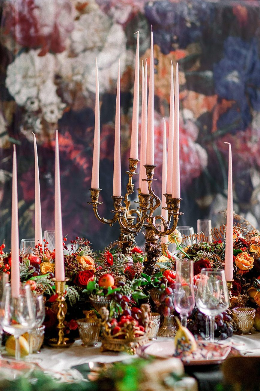 Baroque wedding picture of candles on a table with flowers