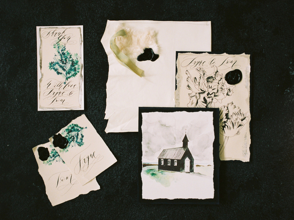 Illustrated wedding invitations with floral designs and a wedding venue from Iceland illustrated as part of a wedding suite