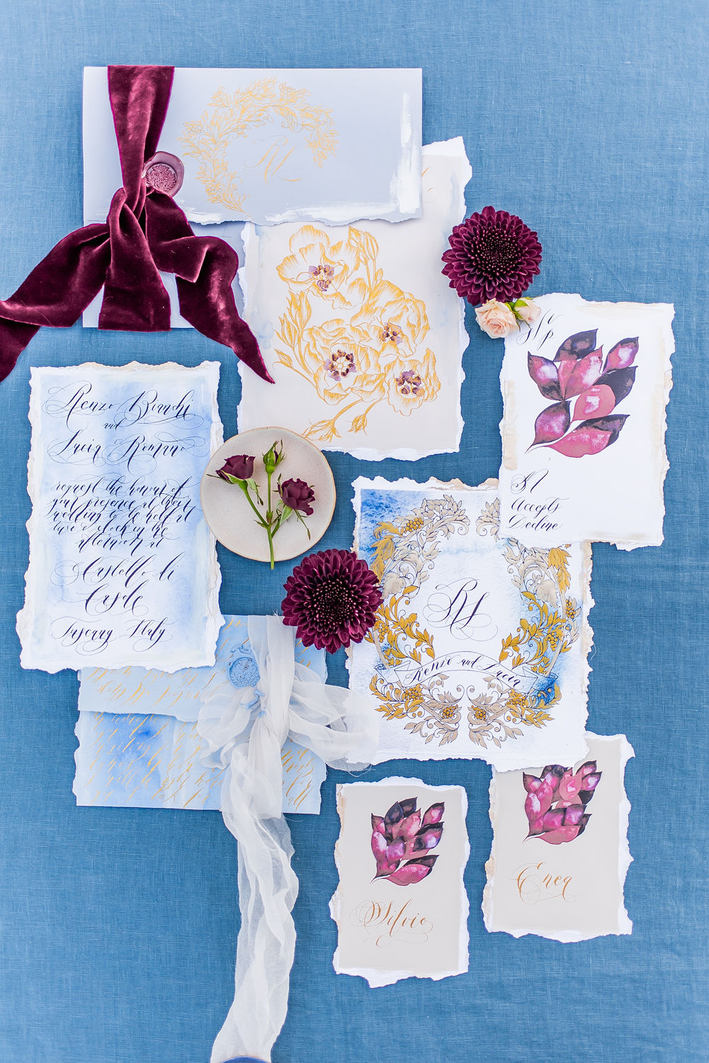 This is a flat lay image of wedding stationery, with blue and gold colours. It shows how to lay out and style your vow renewal stationery