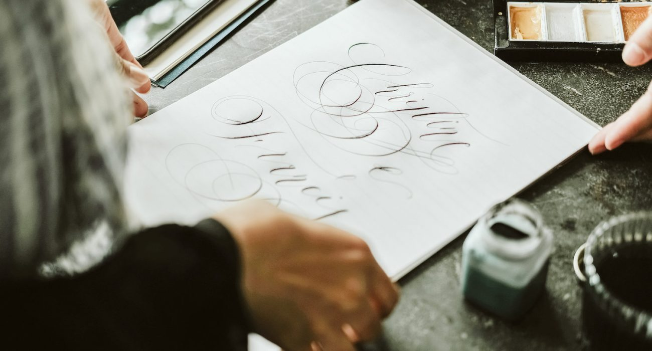 Marketing to wedding planners showing caligraphy designs to a venue owner