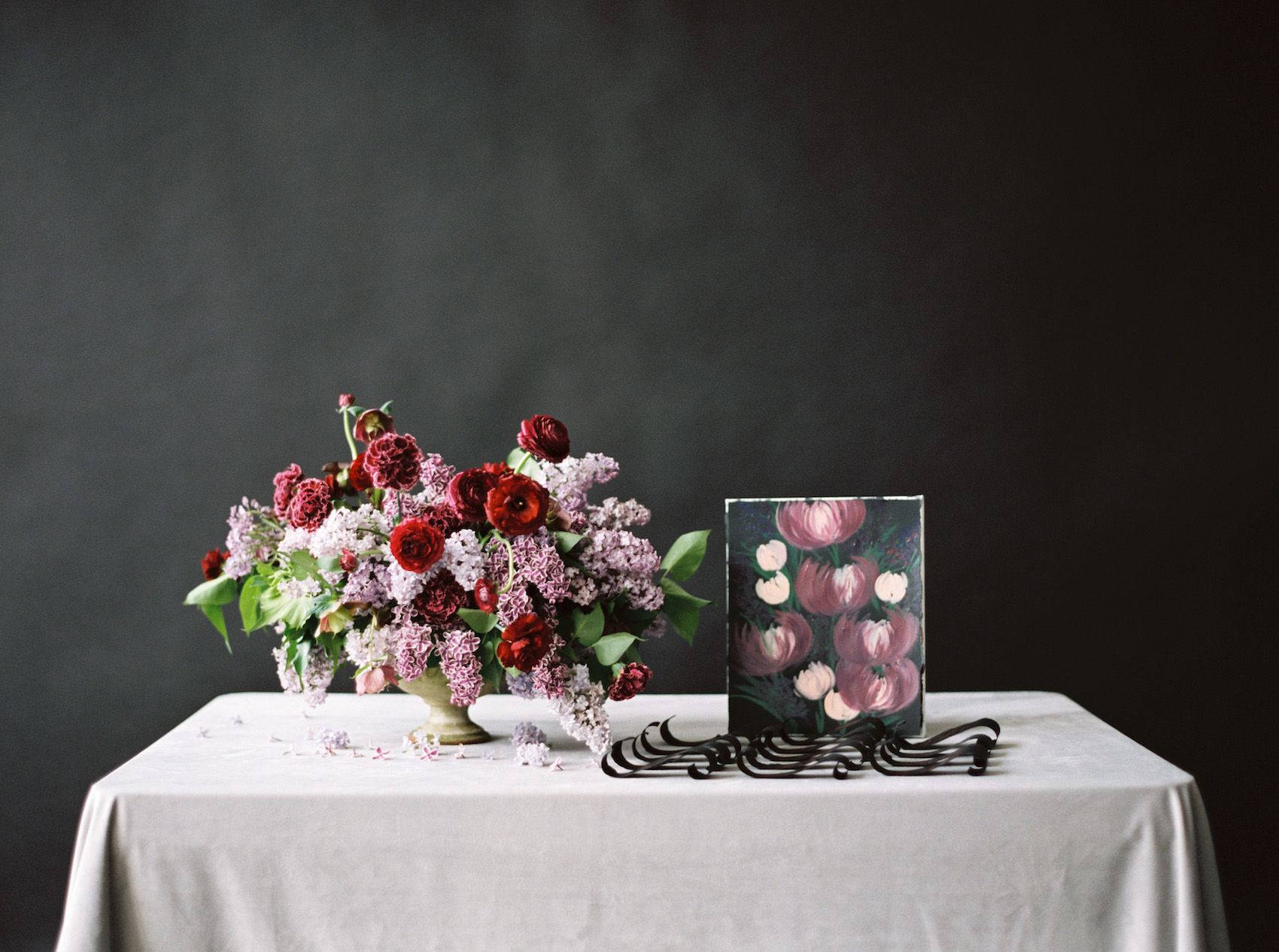 Escort card and place names table idea with flowers and art display