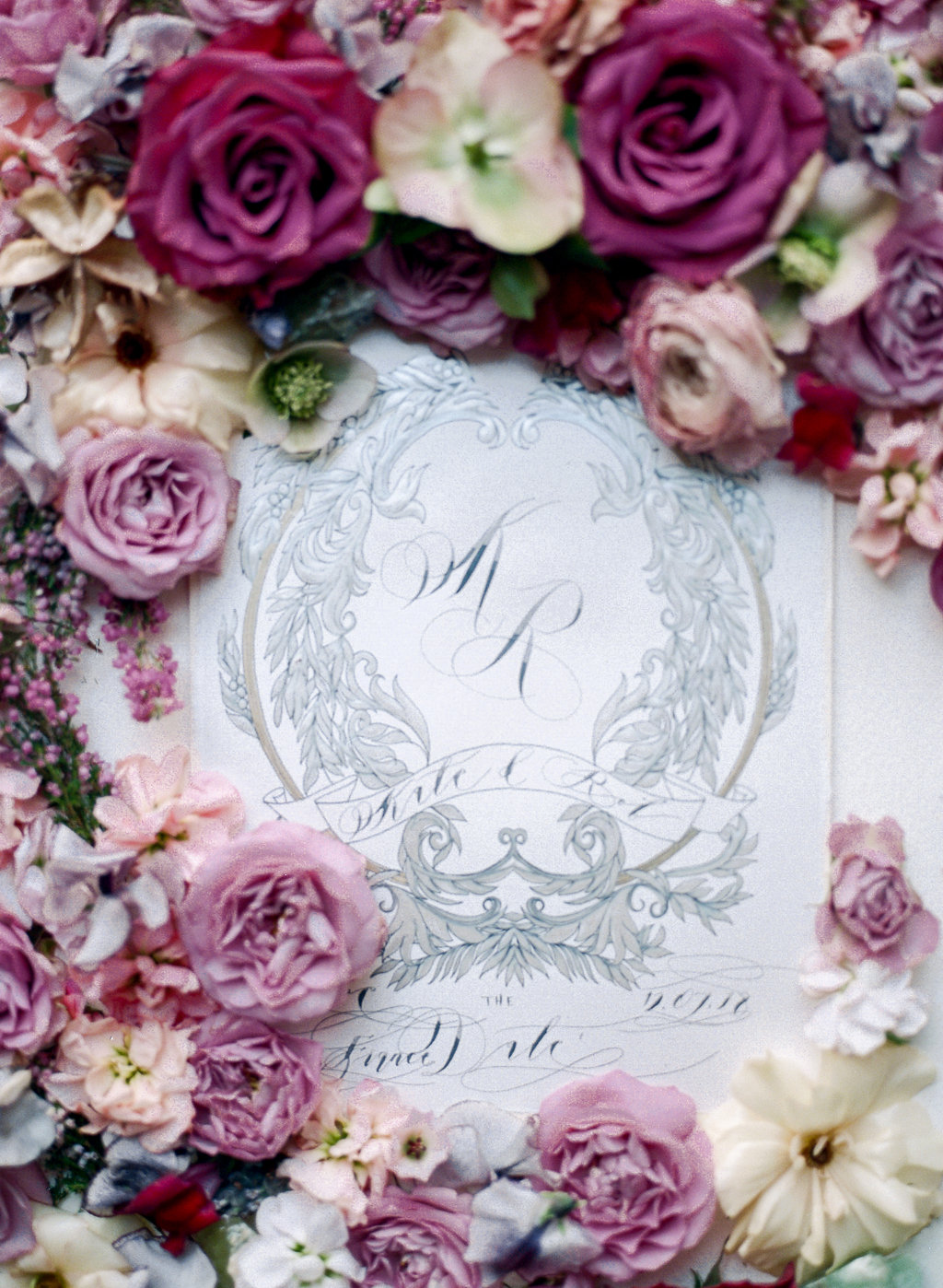 Luxury event invitations with silver crest design