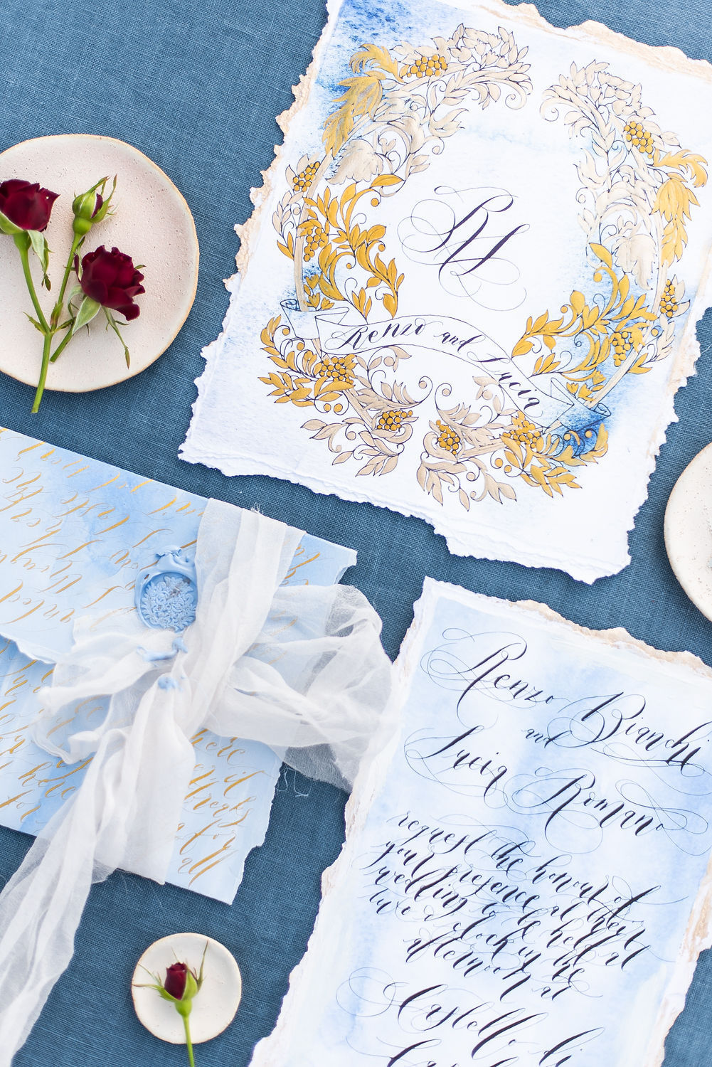 Weddings stationery tips for destination weddings showing luxury wedding stationery with blue and gold