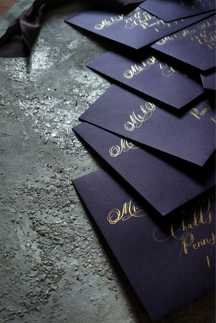Aubergine envelopes with calligraphy