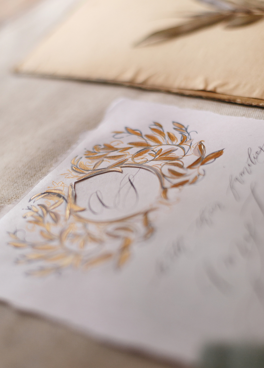 Cliveden House Wedding showing invitations with crest design in gold