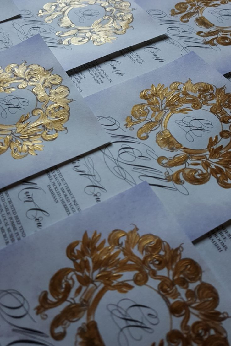 Gold Crest design with black calligraphy for a bespoke wedding stationery menu design