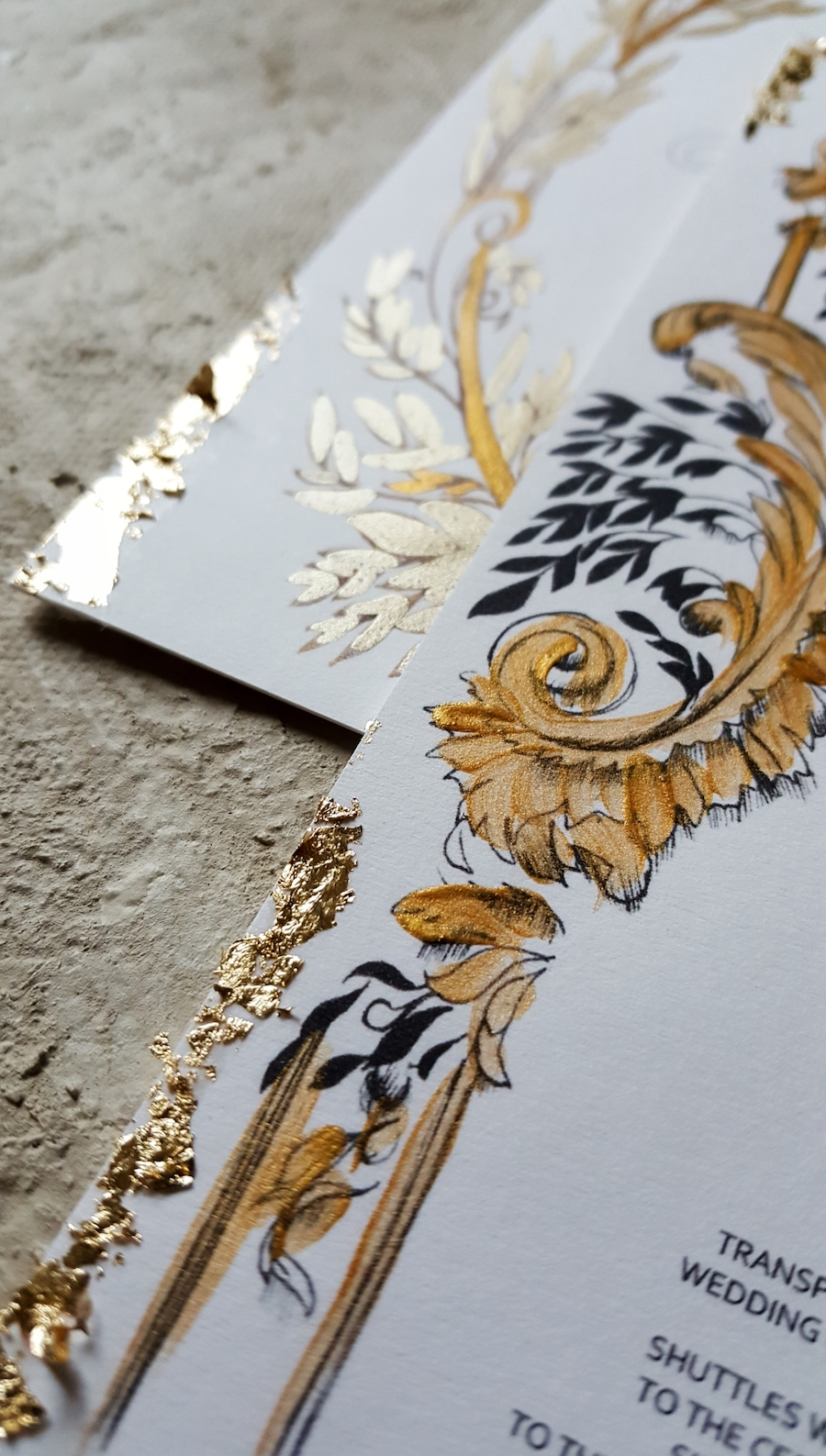 Gold detail on a printed wedding stationery suite