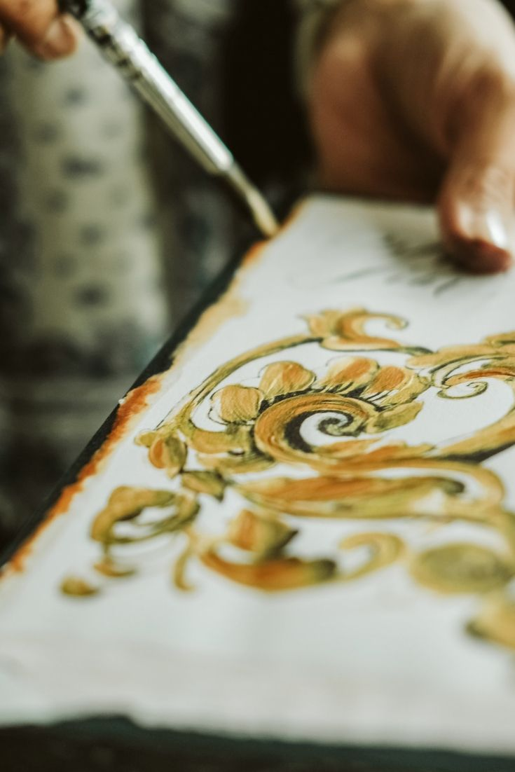 Hand painting the edges to create a really distinct edge for some custom watercolour invitations