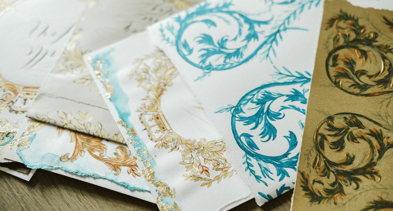 Questions to ask your wedding stationer featuring a blue and gold regal stationery suite