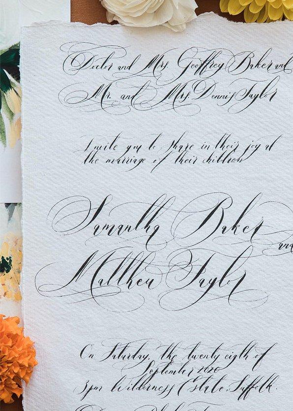 Black calligraphy on hand made white paper for a love letter style invitation