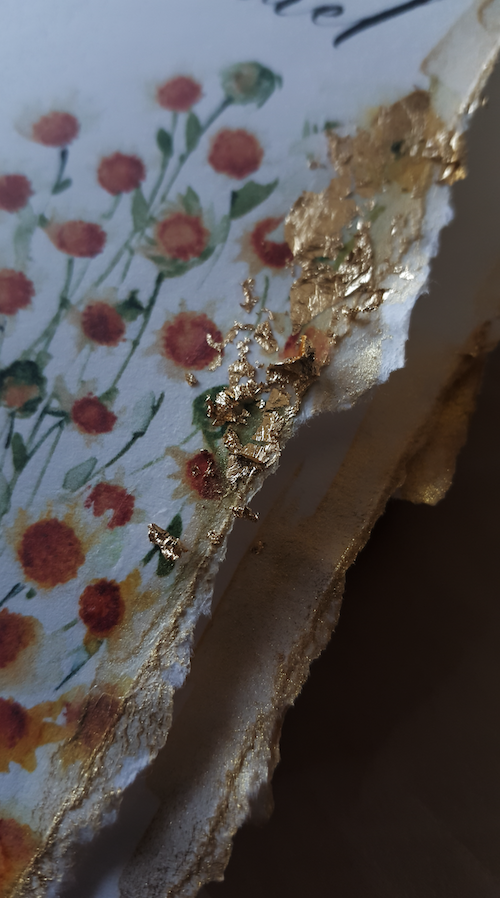 Hand torn - deckled edges with gold foil leaf for a floral watercolour ceremony booklet