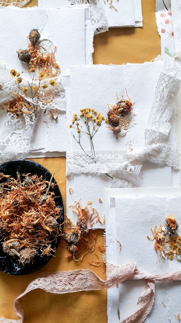 Pressed wildflowers with hand made fine art, watercolour wedding stationery
