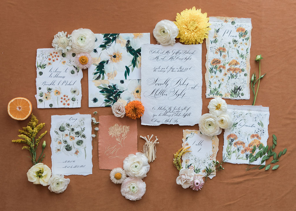 Hand painted watercolour wedding invitations designed with delicate floral patterns