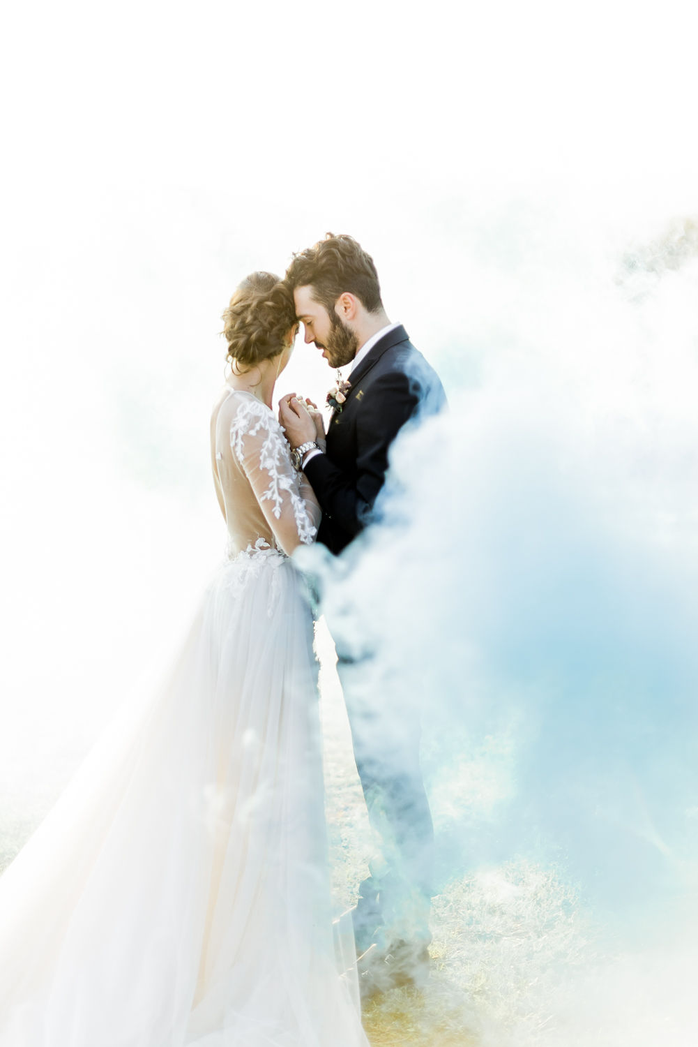 Smoke bomb with the bride and groom