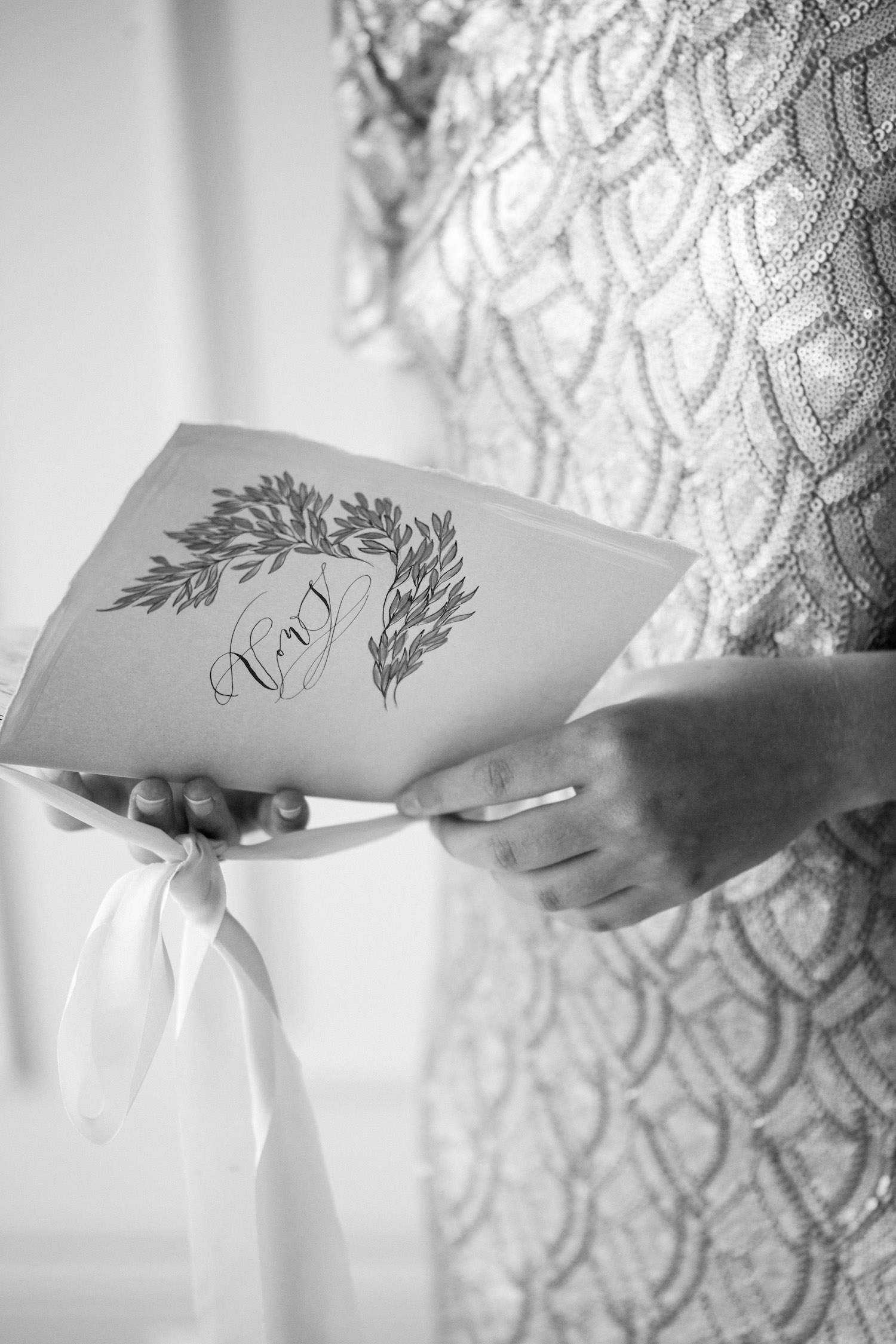 Vow book with hand painted leaves design and vows calligraphy