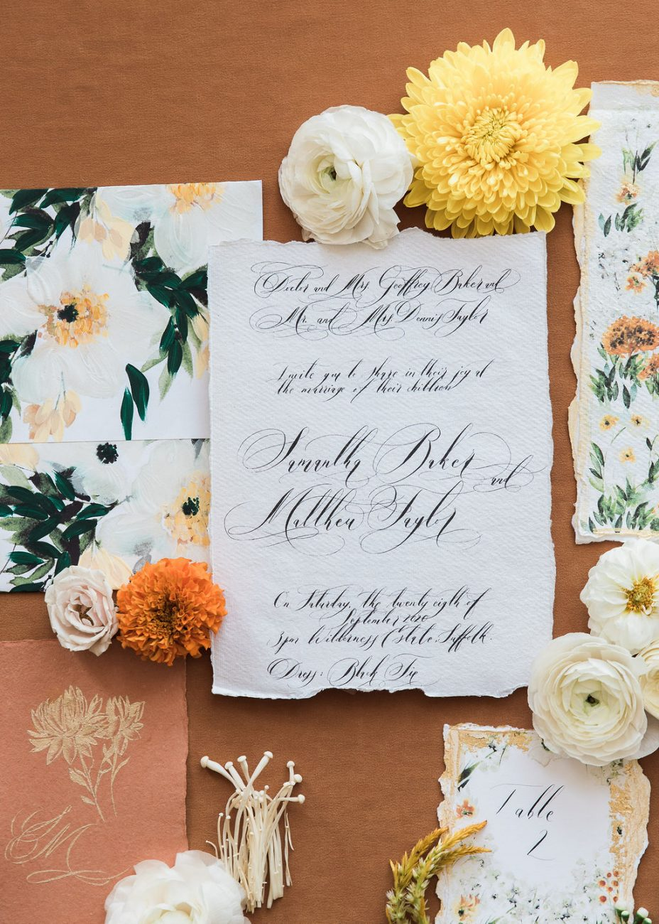 Watercolour fine art wedding stationery suite, with orange, gold and white and green florals