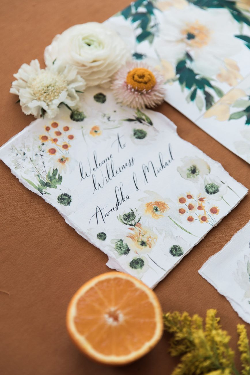 Wedding day stationery welcome booklet designed with wildflowers and daisies