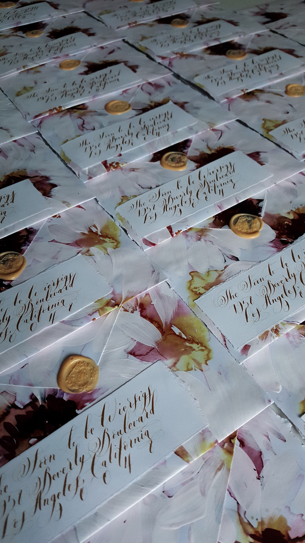 Hand made and hand painted envelopes with gold calligraphy and wax seals for a fine art, floral wedding