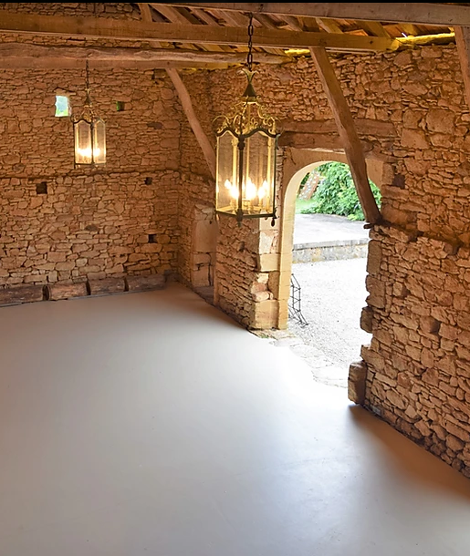 Rustic wedding venue in France with a large indoor barn area