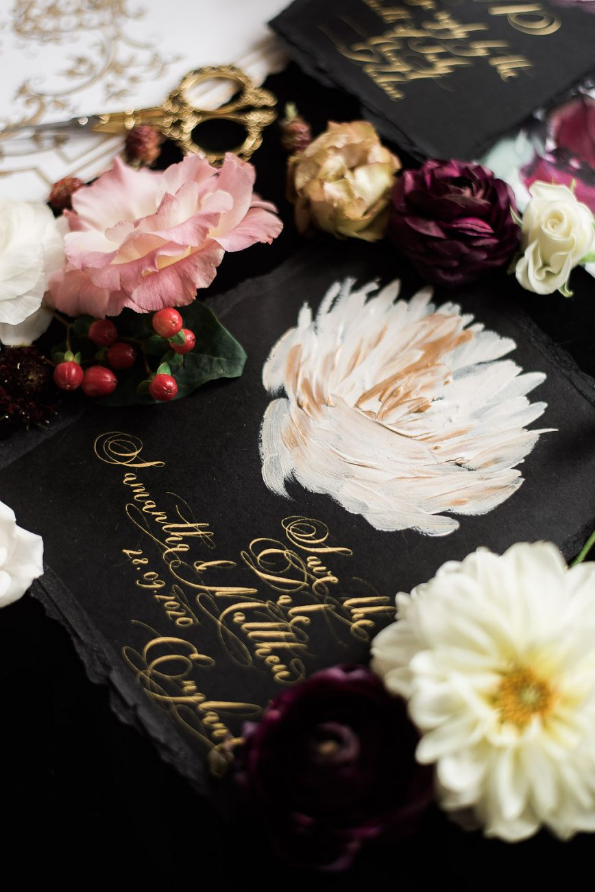 Black save the date card with hand painted floral detail