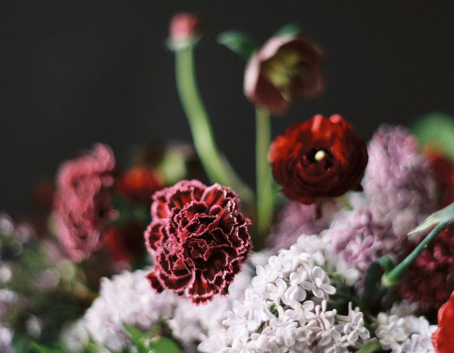 Fine art floral with deep reds, pale lilac and greens for a luxury moody floral arrangement