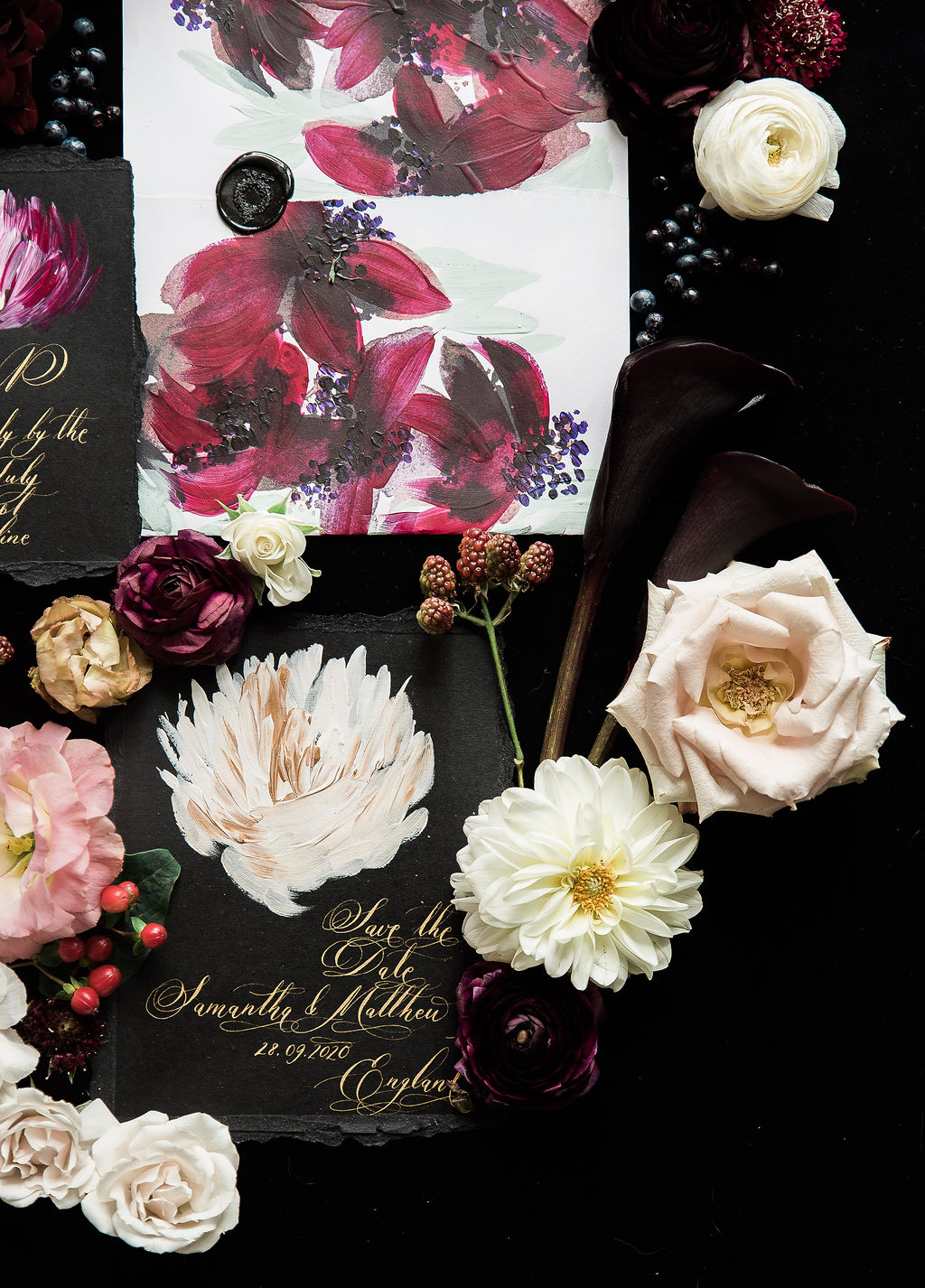 Floral wedding inspiration with wine coloured, hand painted envelope