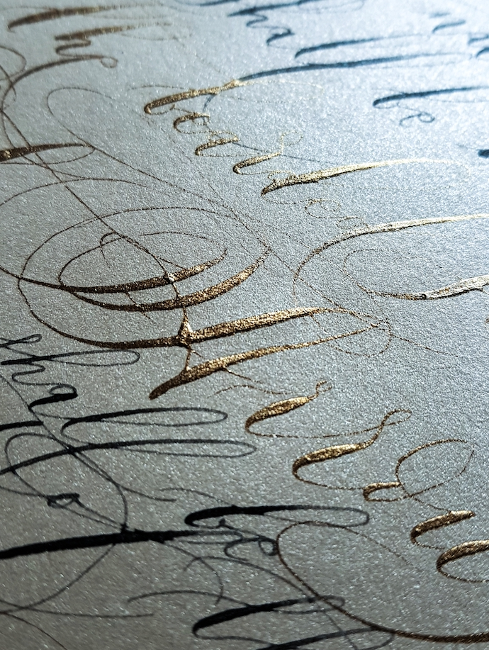 Gold and black calligraphy with large flourishes