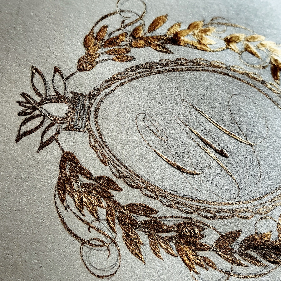Gold crest design using calligraphy dip pen