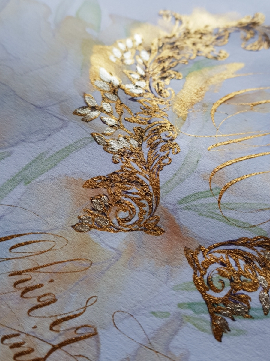 Gold watercolour and calligraphy art crest design for fine art luxury wedding invitations for The Ritz, Paris.
