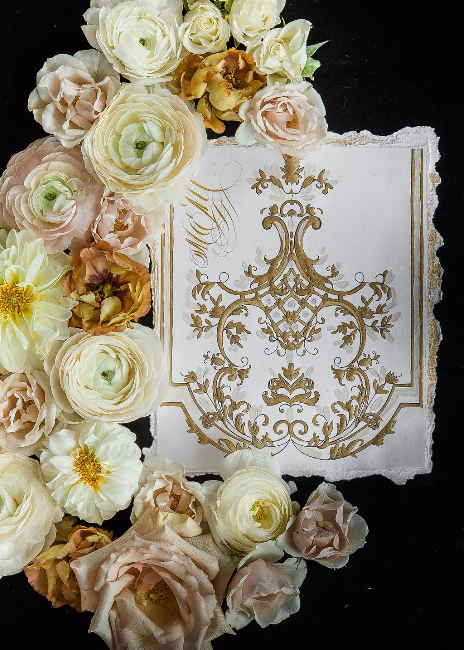 Hand painted white, cream and deep gold wedding menu design with hand torn edges painted in gold
