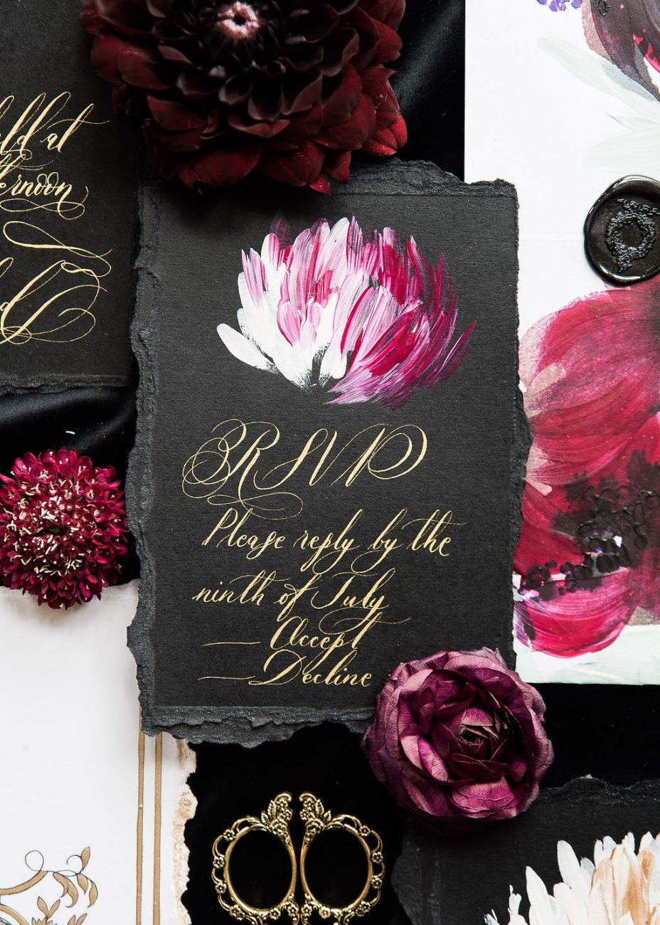 Luxury wedding stationery with a dark and moody edge with bold deep plum and magenta flowers