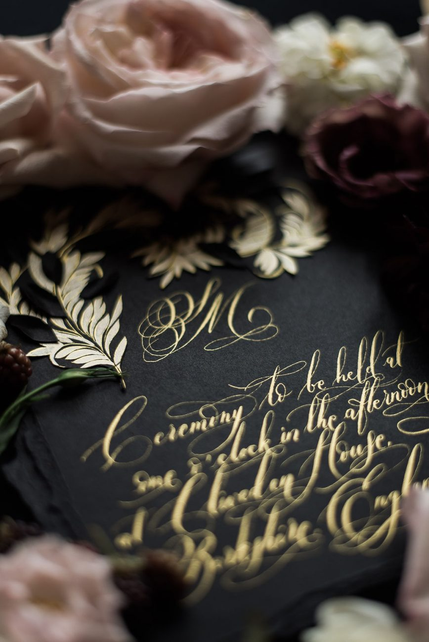 Moody - Romantic French style black and gold wedding invitation styled with pink roses