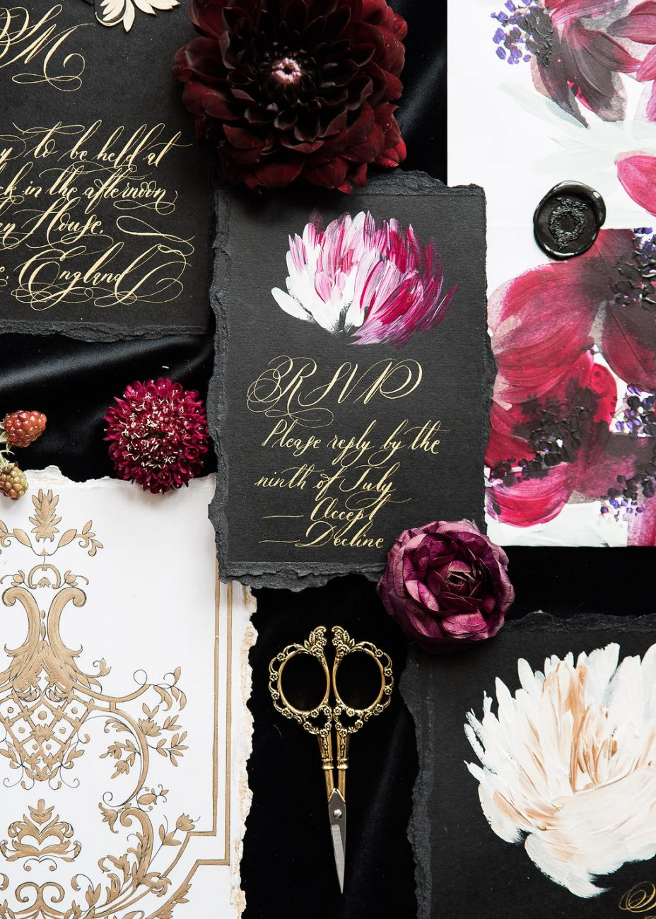 Rsvp card with gold fine art calligraphy and magenta flowers on a black card