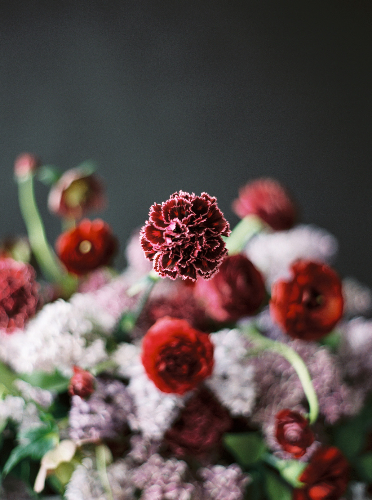 Small deep red flowers for a luxury wedding floral arrangement