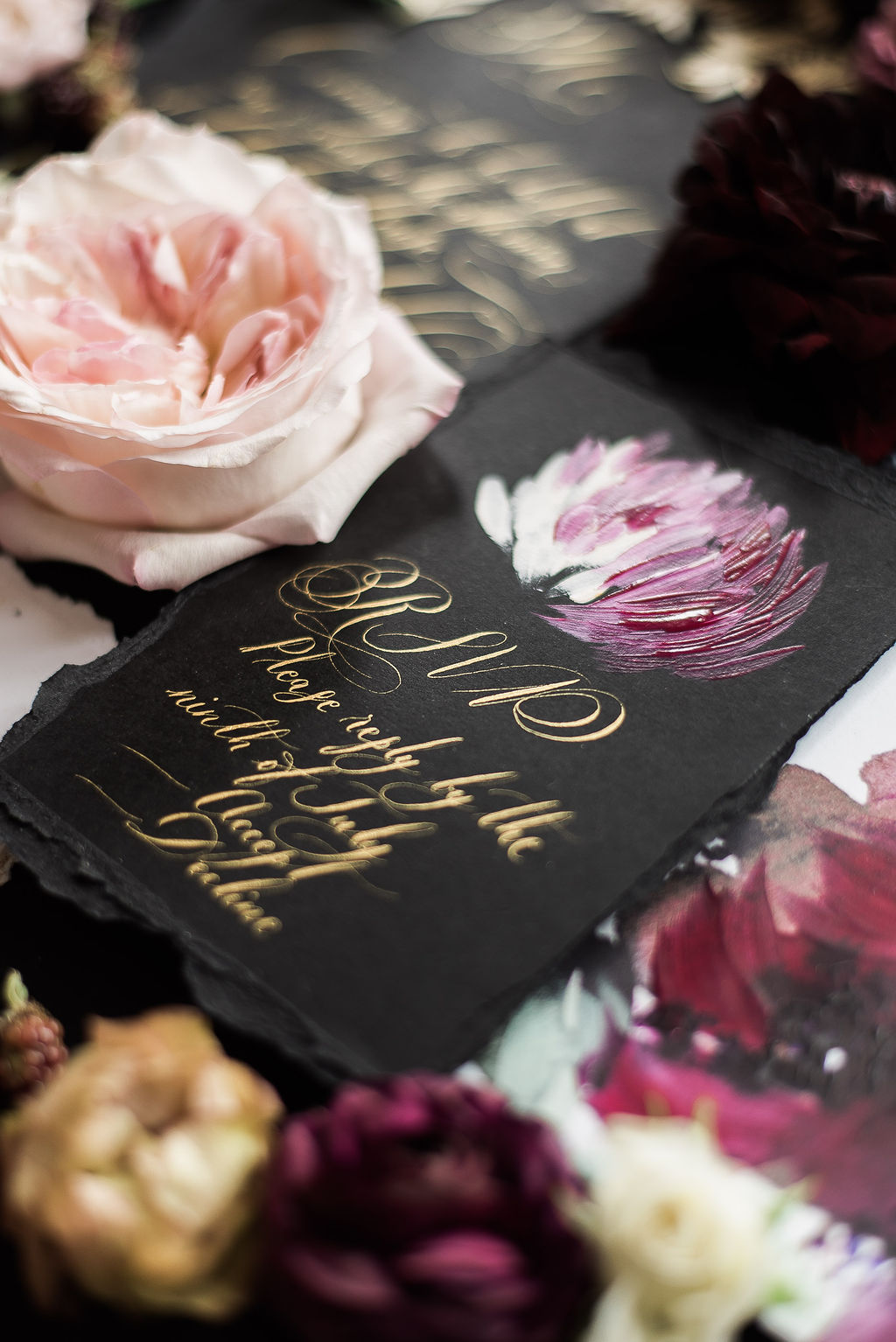 Black rsvp card in gold calligraphy and a magenta, deep pink hand painted floral design